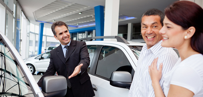 Couple with car salesman